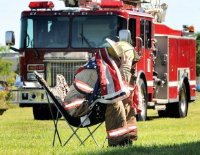 Quiet tribute: City firefighters at the Lipe Art Park